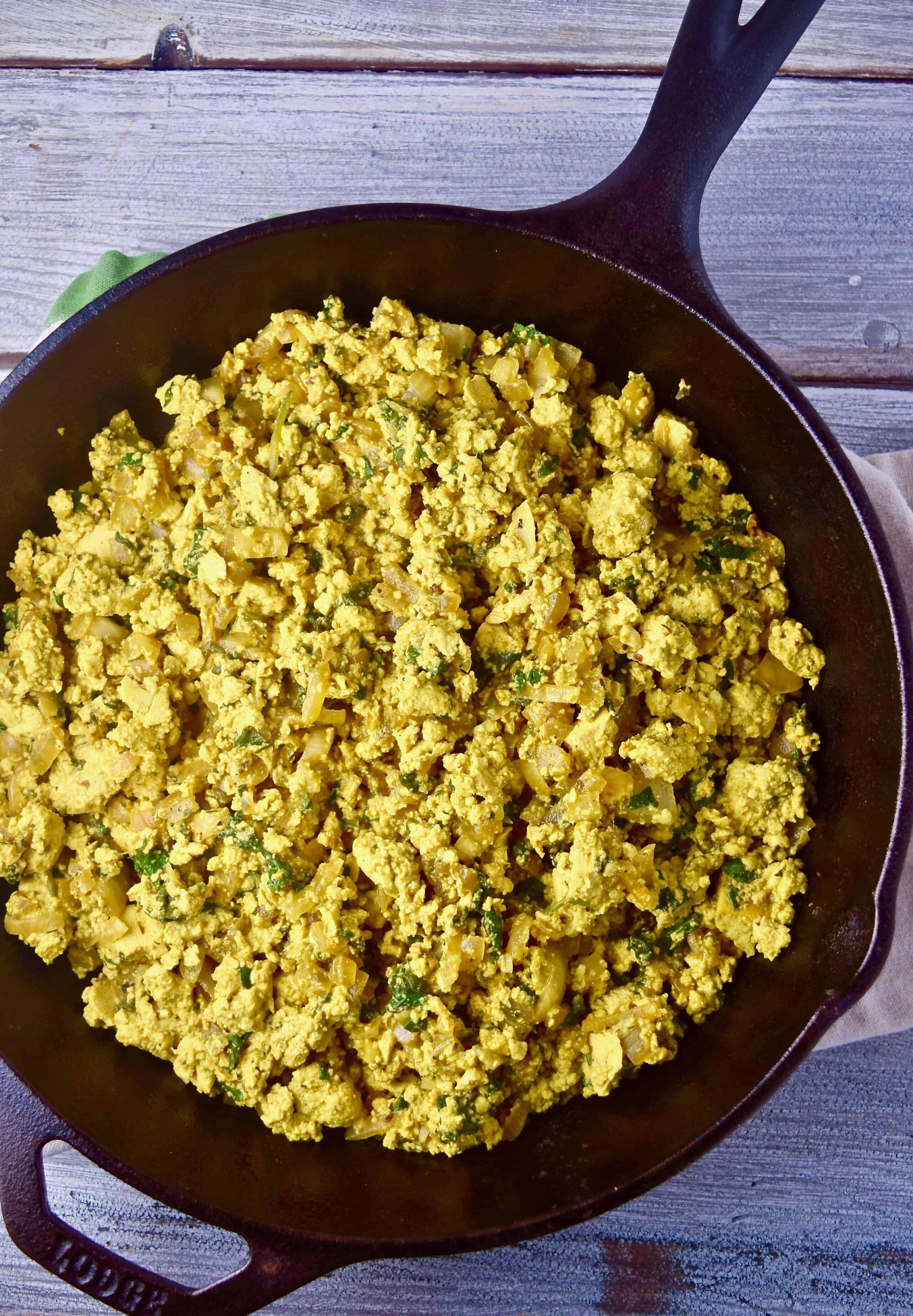 Tofu breakfast scramble in cast iron skillet.