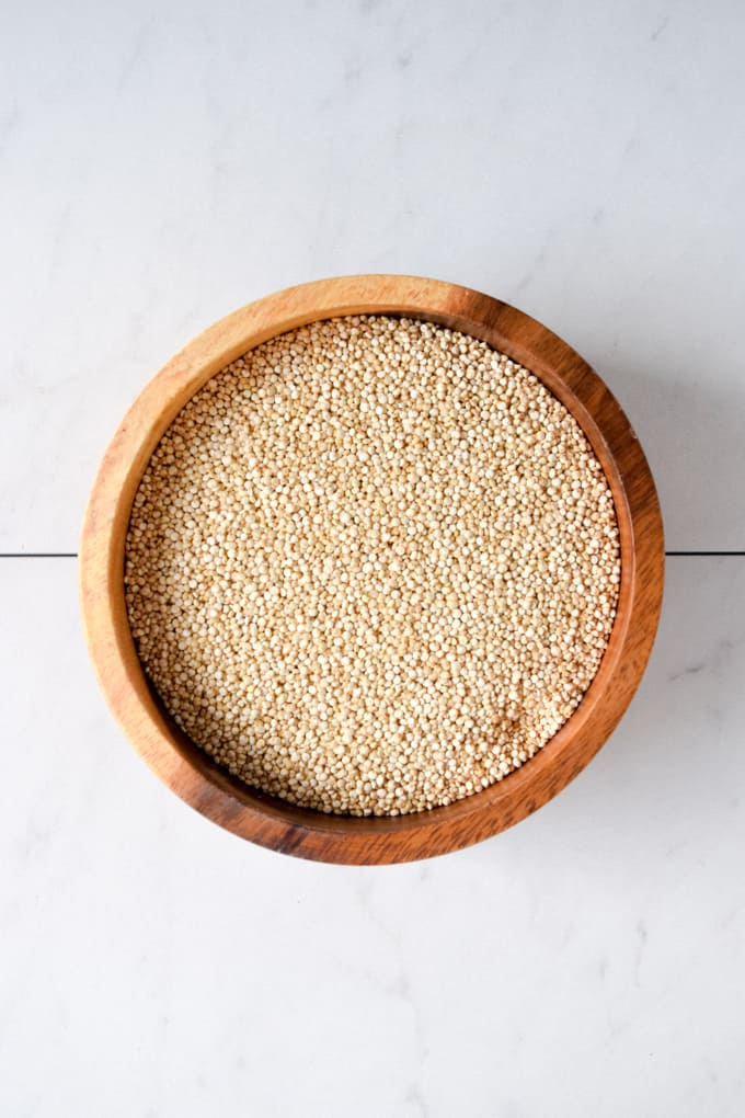 wooden bowl of uncooked quinoa.