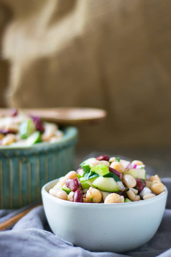 three bean salad in white bowl