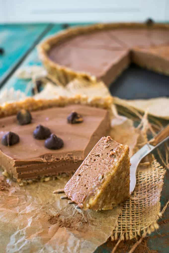 no-bake chocolate peanut butter pie on blue table