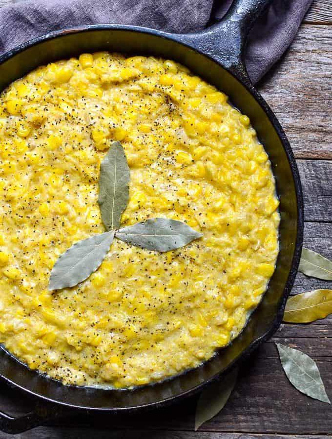 Homemade Vegan Creamed Corn closeup in cast iron skillet