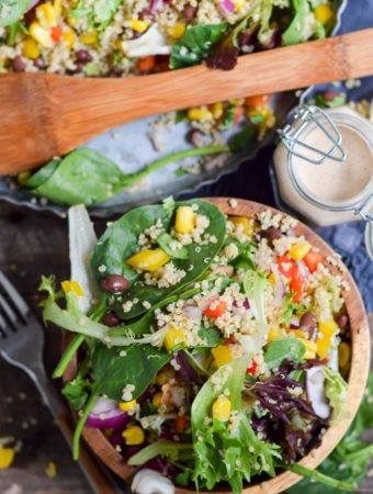 Black Bean Quinoa Summer salad in bowl with tray