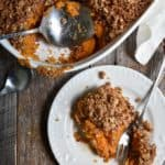 Crunchy Pecan Sweet Potato Casserole on plate with fork.