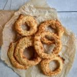 Best damn vegan onion rings on parchment paper.