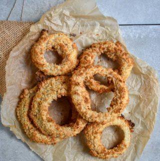 Best damn vegan onion rings on parchment paper.