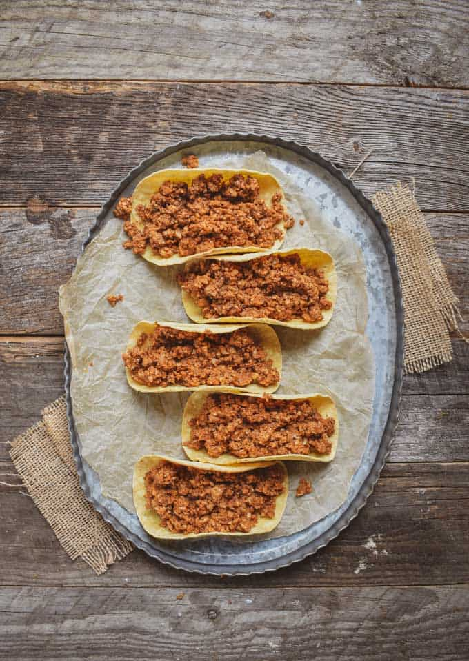 Cauliflower mushroom walnut vegan taco meat in taco shells.