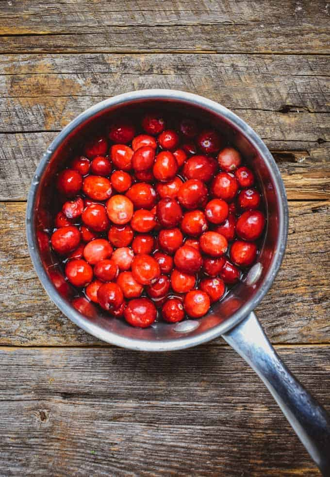 Fresh cranberries in sauce used for cranberry sauce.