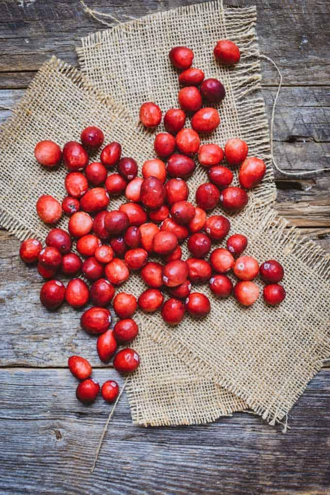 Fresh cranberries on burlap.