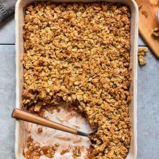 Cinnamon apple oatmeal crumble in baking pan.