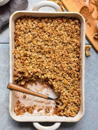 Cinnamon apple oatmeal crumble in baking pan.