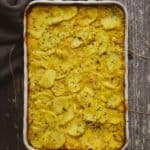 creamy vegan scalloped potatoes in baking dish.
