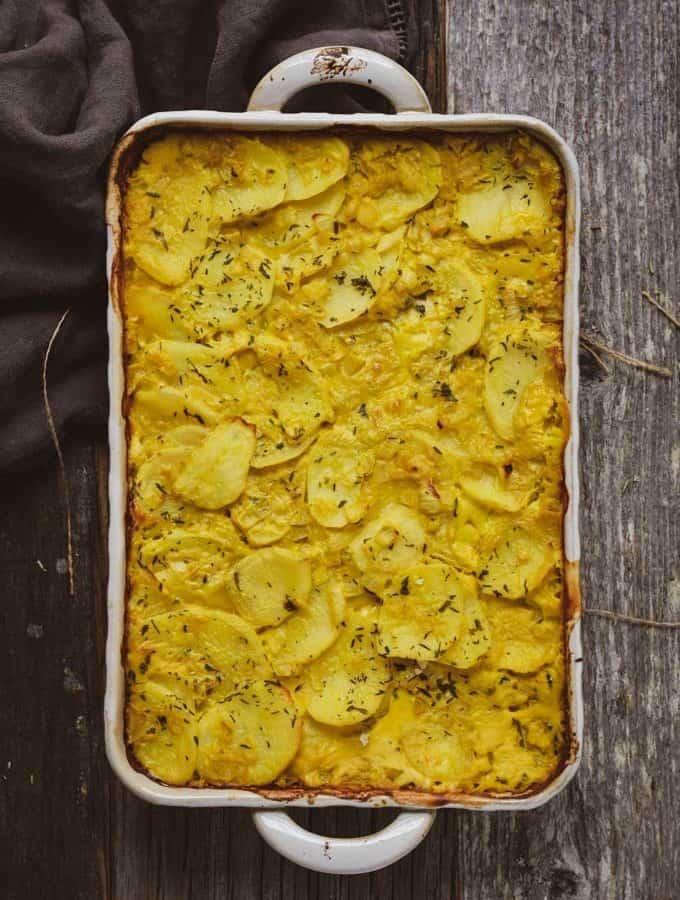 creamy vegan scalloped potatoes in baking dish.