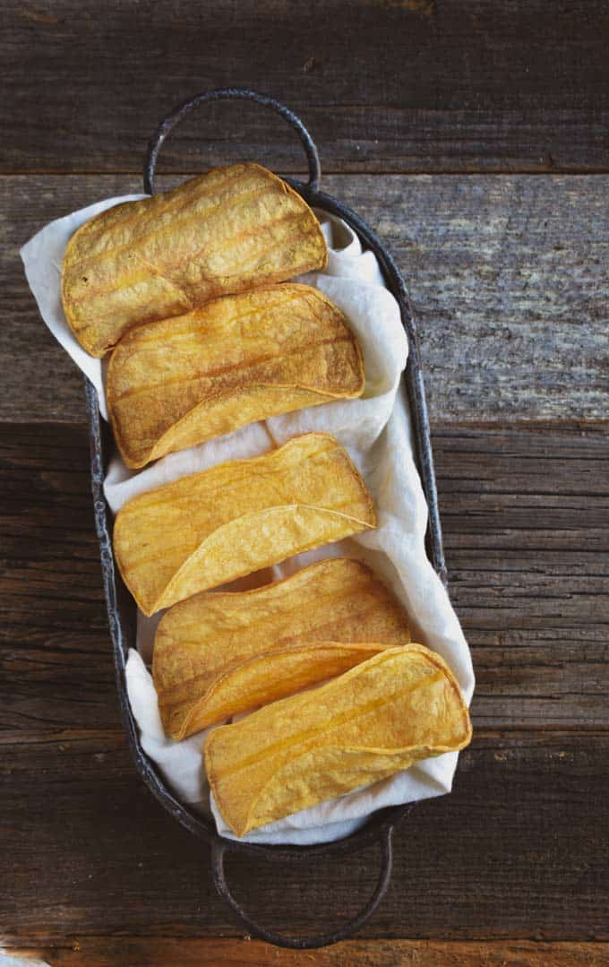 Crunchy baked taco shells in basket.