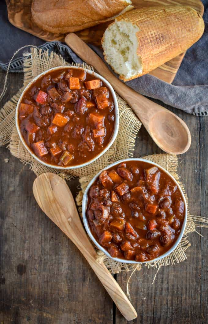 Two bowls of sweet potato black bean chili with no toppings.