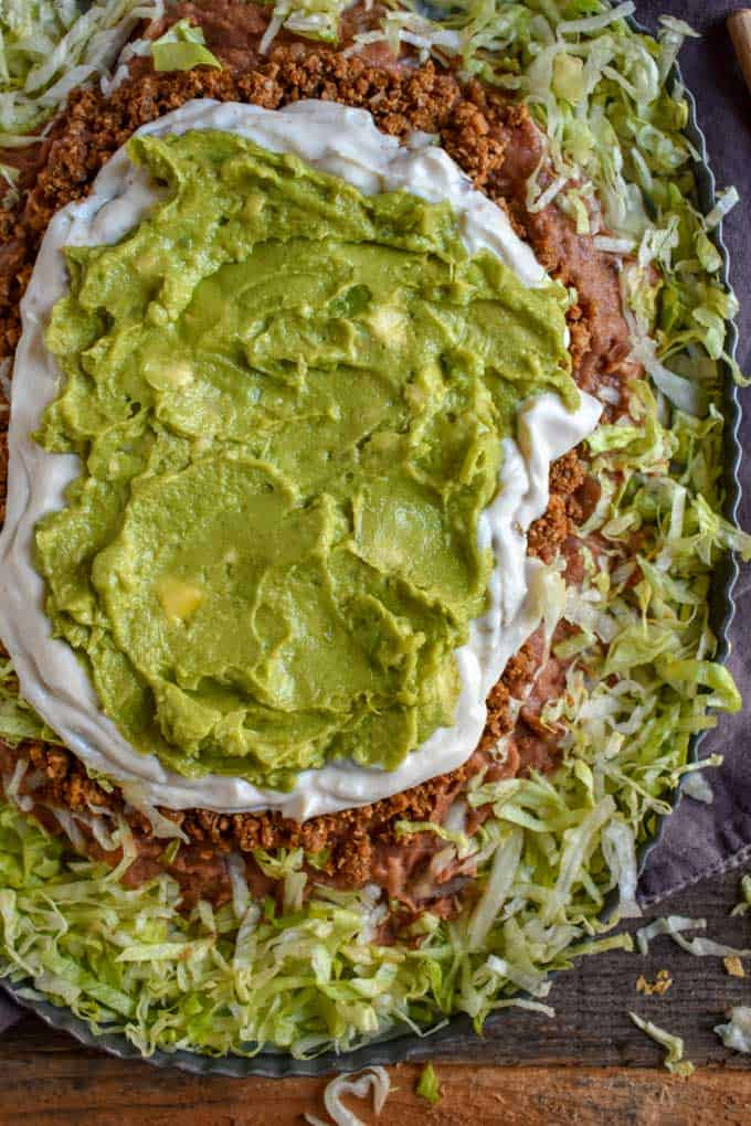 Guacamole on top of Mexican Seven Layer Bean Dip recipe.