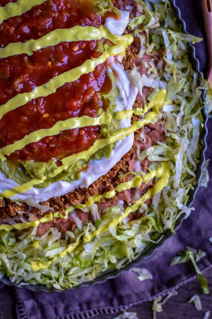 Mexican Seven Layer Bean recipe with cheese sauce.