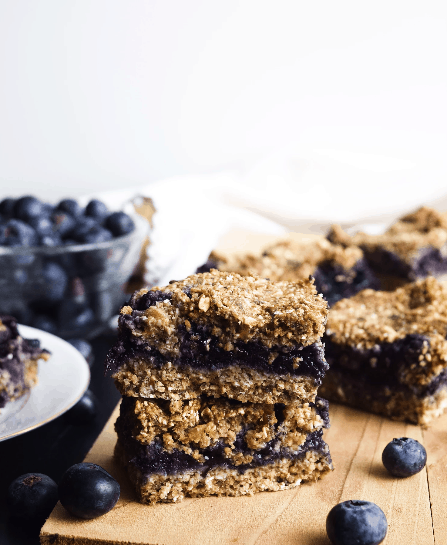 blueberry crumble bars on table.