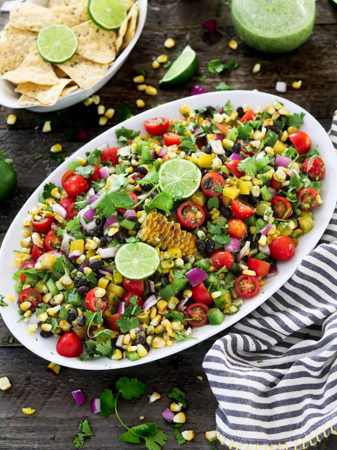 Grilled corn salad in serving tray on table.