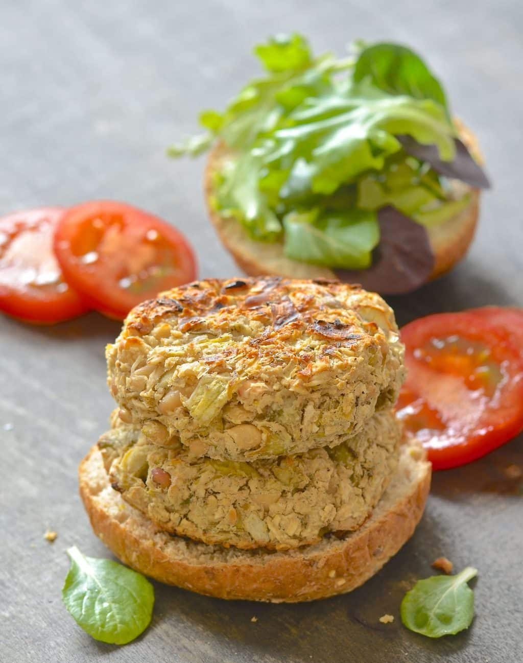 white bean artichoke burgers on bun