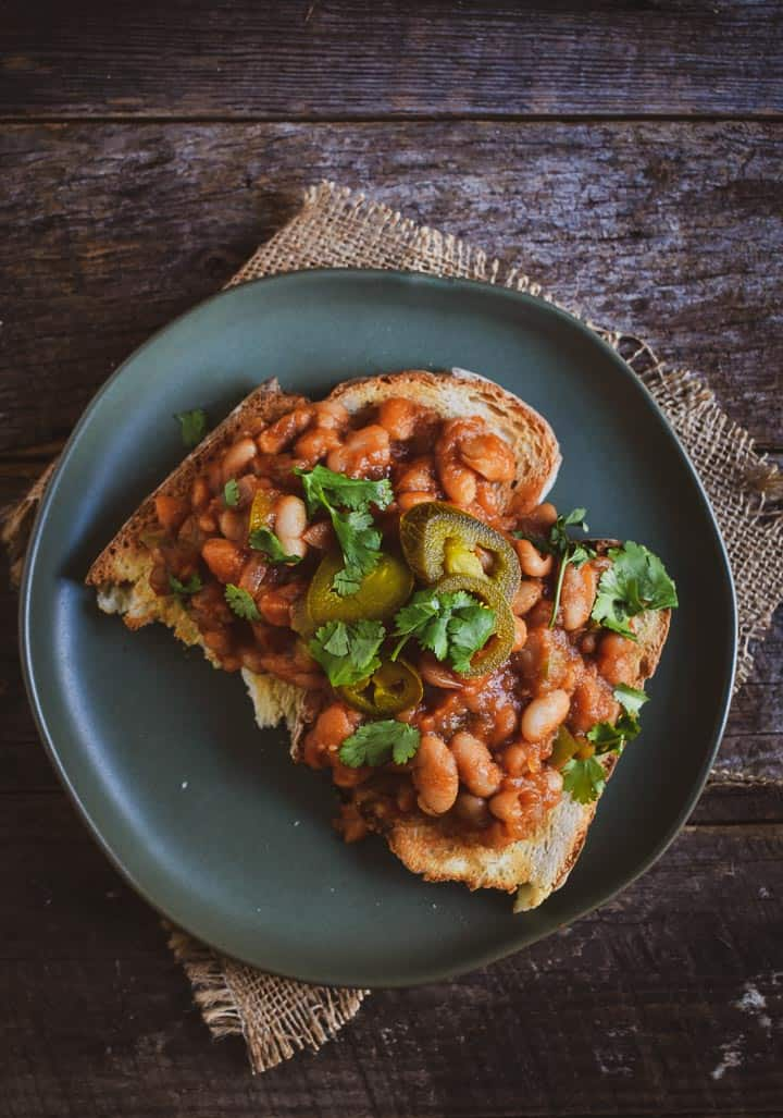 barbecue baked beans on toast with jalepenos.