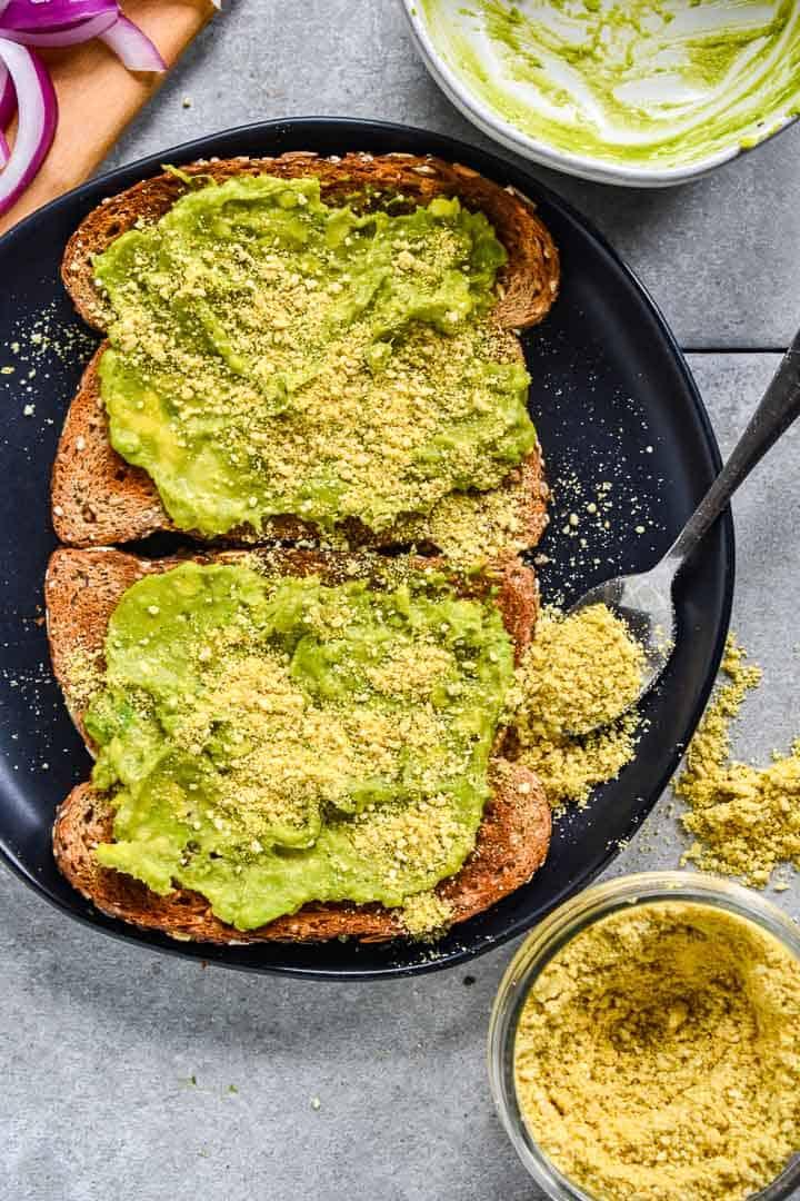 Vegan parmesan with avocado on toast.