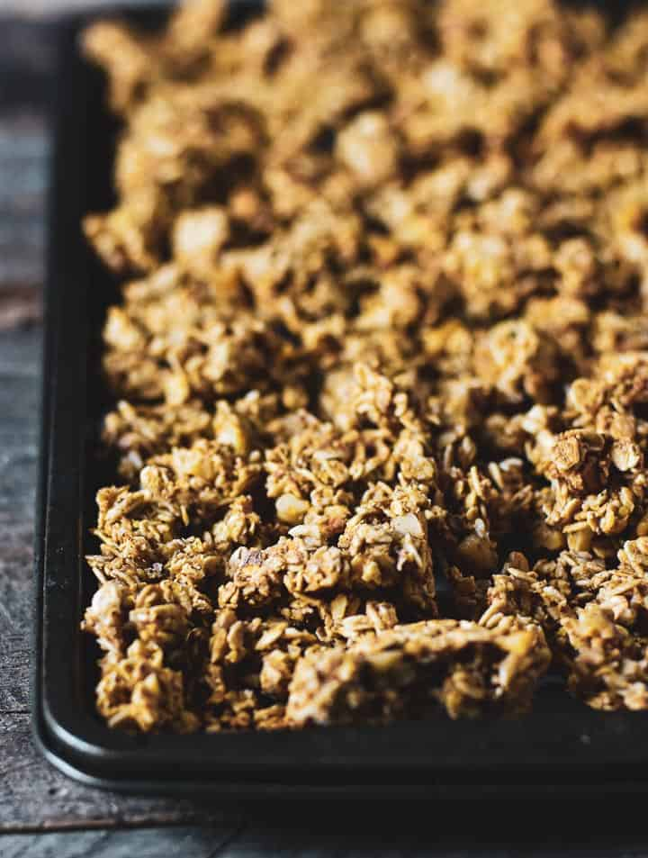 Healthy oil-free granola on baking sheet.