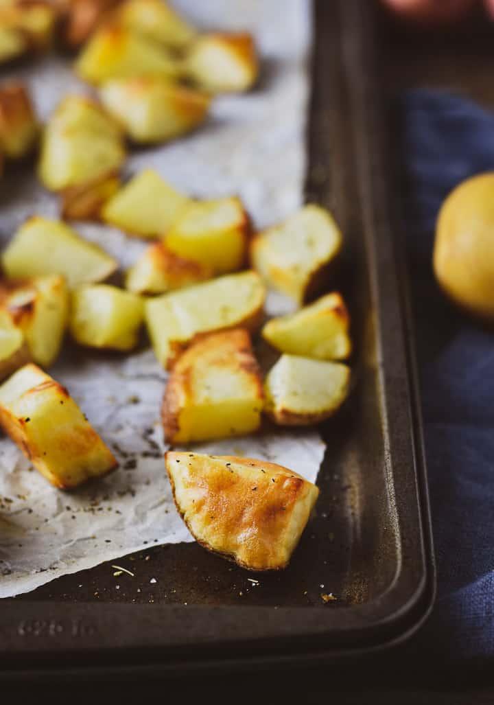 Roasted potato on a baking sheet.