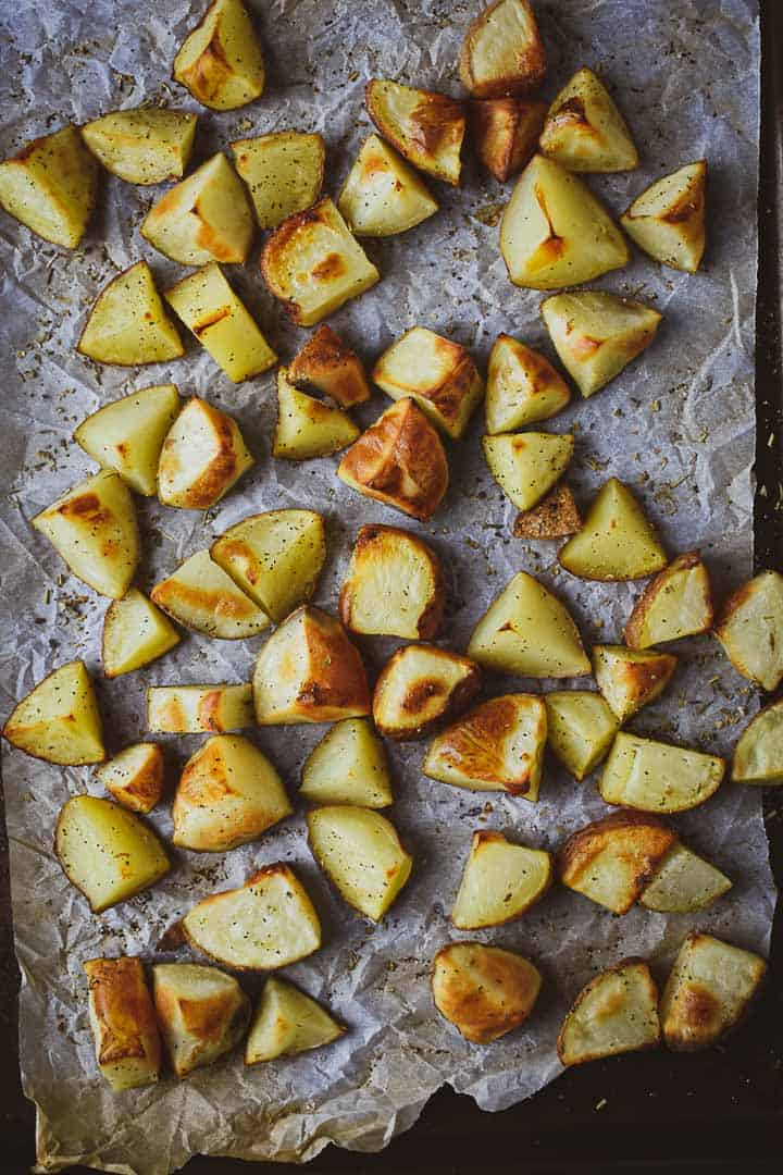 oil-free oven roasted potatoes on a baking sheet.