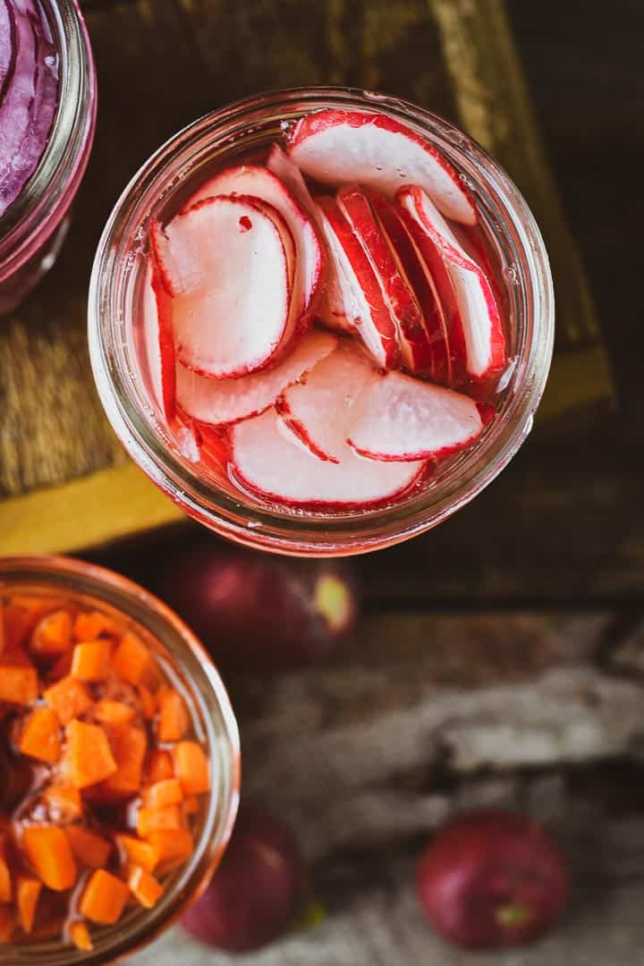 Pickled radishes in jar with no lid.
