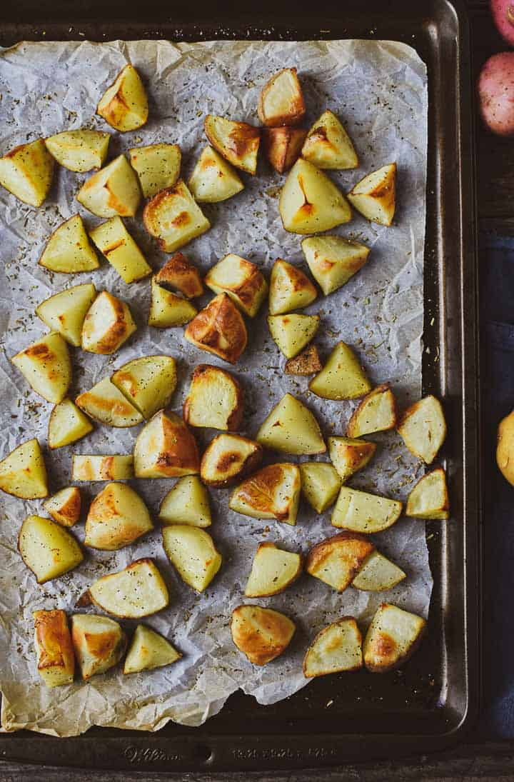 Oil-free oven roasted potatoes on baking sheet.