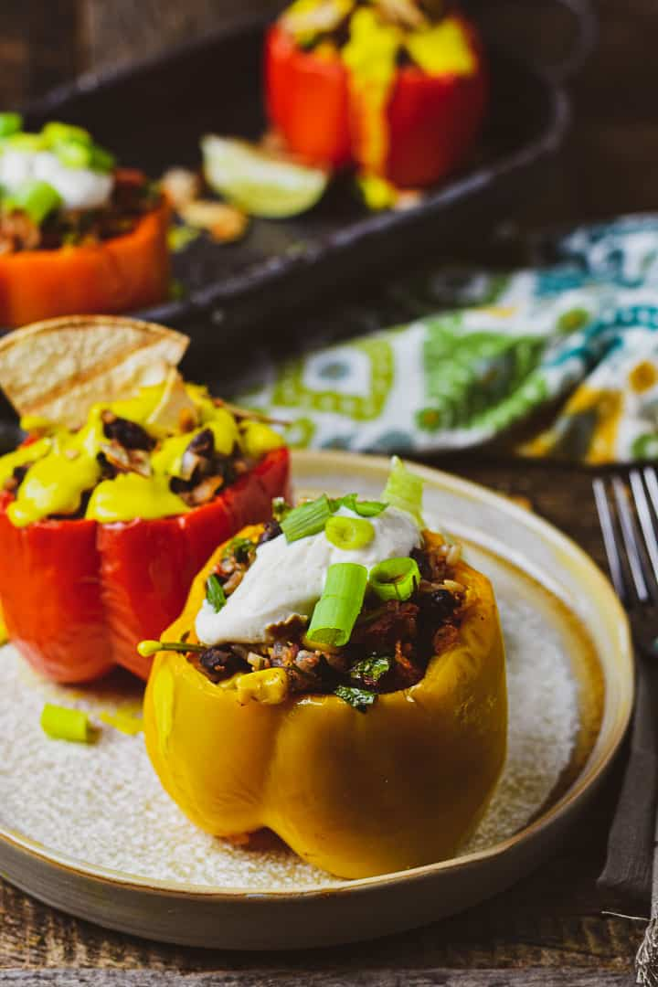 Stuffed bell peppers on plate.