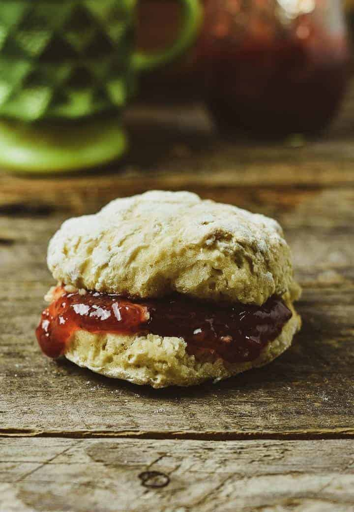 Vegan biscuit with jam on table.