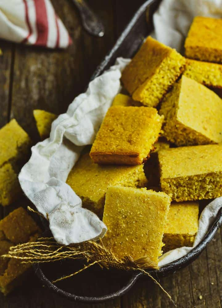 Vegan cornbread in tray with white napkin.