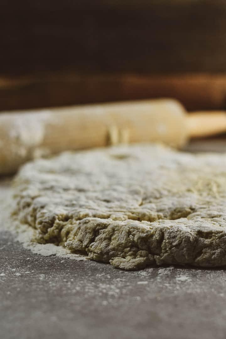 Vegan biscuit dough and rolling pin.