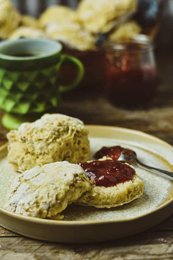 Vegan biscuit with jam on plate.