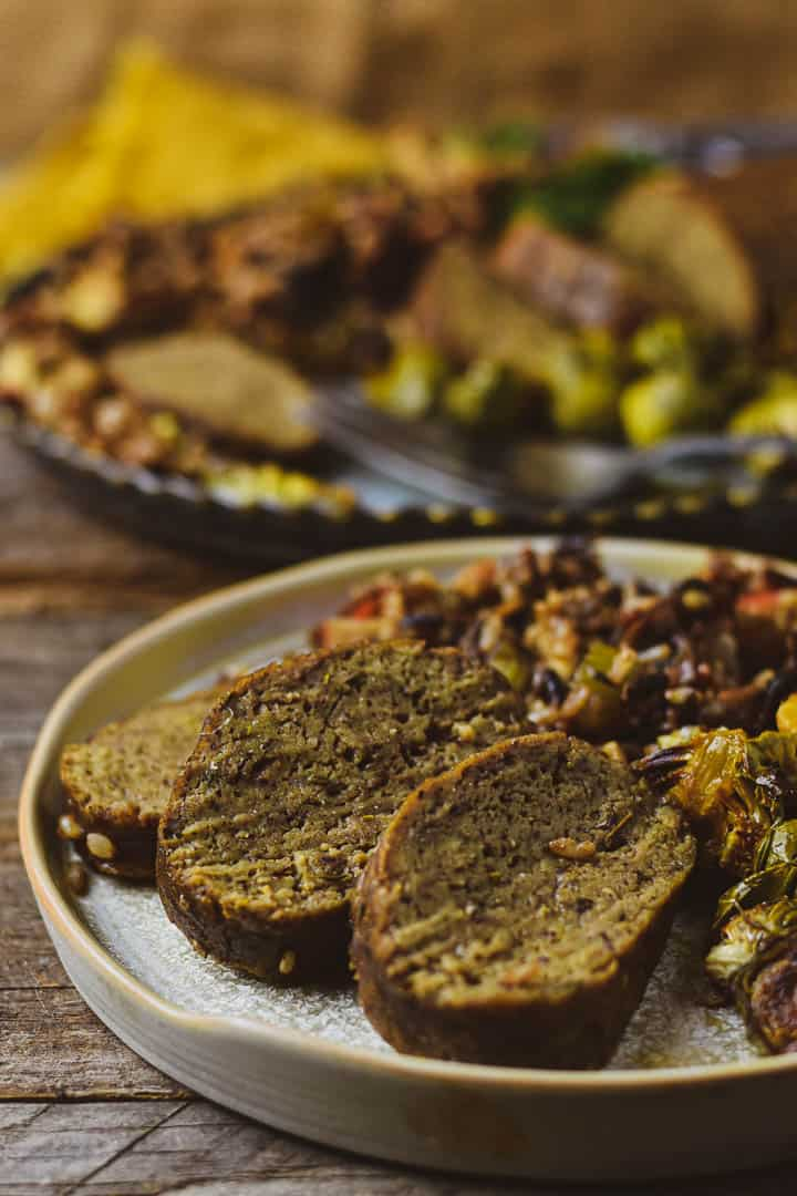 Vegan holiday roast sliced up on a plate.