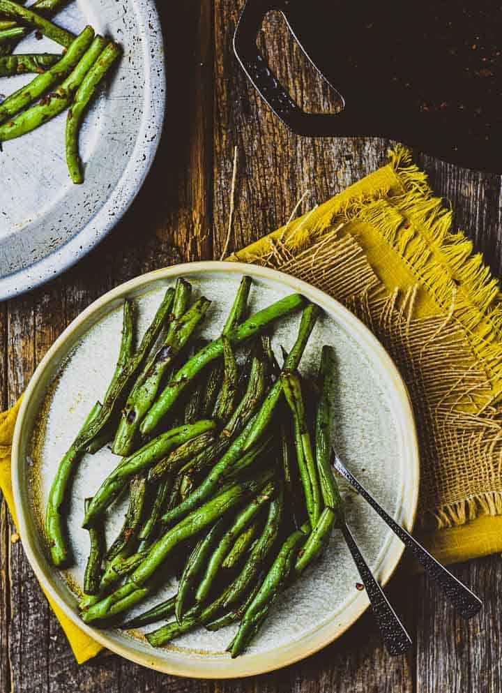 Easy skillet green beans on plate with forks.