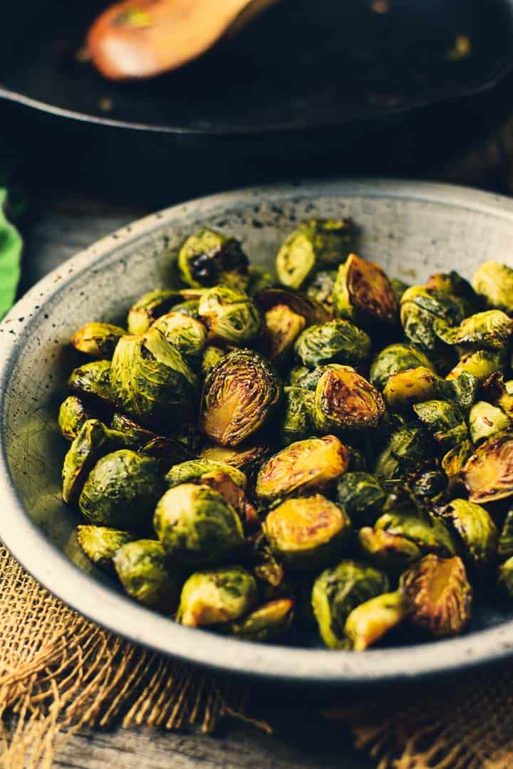 Brussels sprouts in metal bowl.