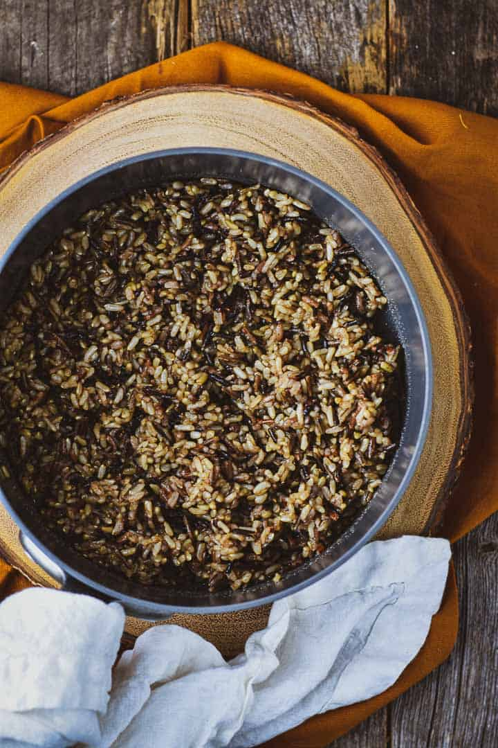 Cooked wild rice in saucepan.