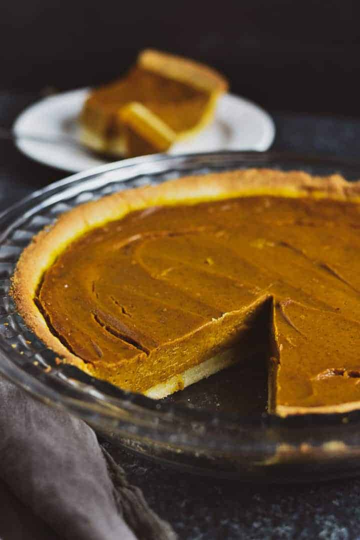 Vegan pumpkin with slice missing.