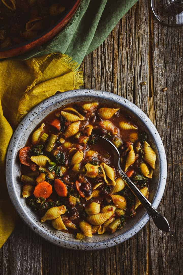 Minestrone in bow with spoon.