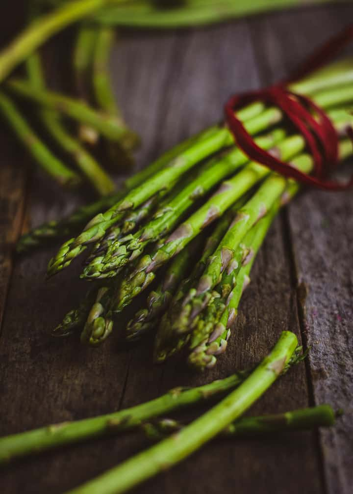 Asparagus tied with red ribbon.