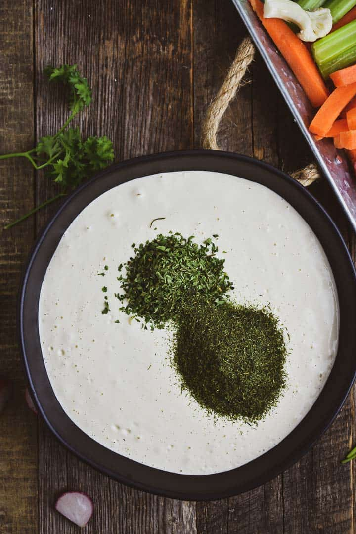 Vegan sour cream with parsley and dill.