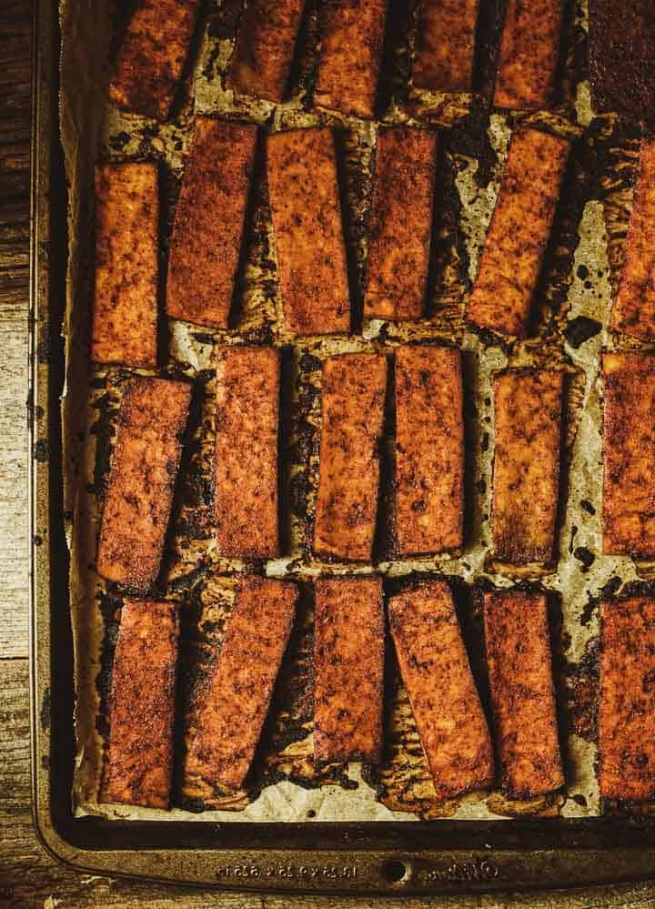 Baked tofu on baking sheet.