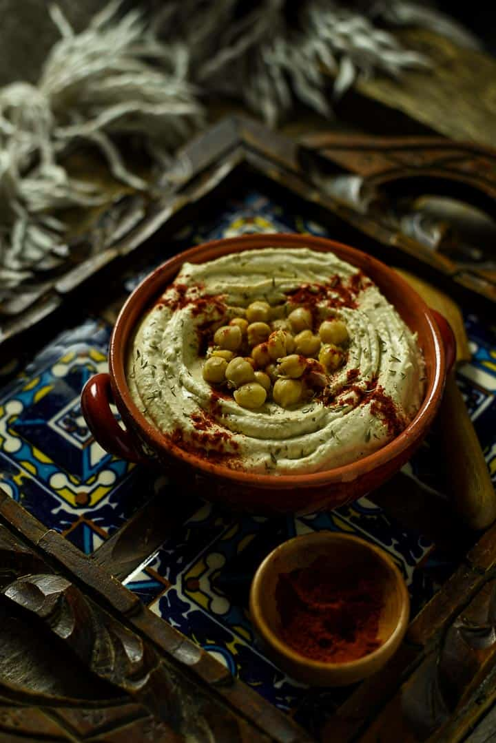 Bowl of hummus with paprika and chickpeas