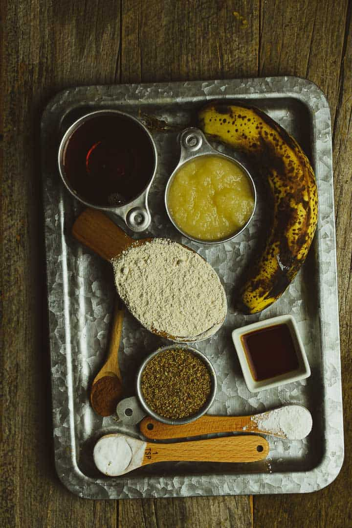 Banana bread ingredients on tray.