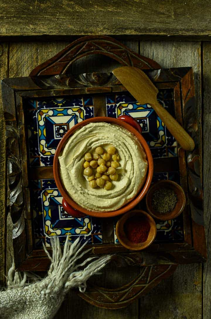 Bowl of hummus with chickpeas.