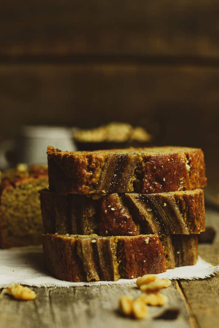Three slices of banana bread stacked.