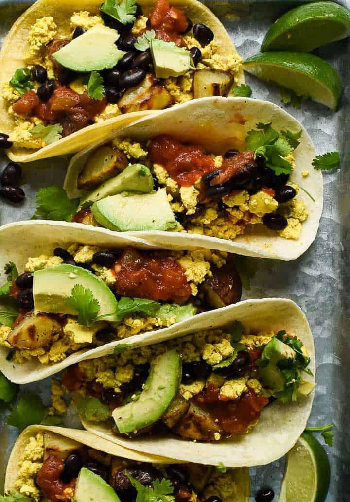 Vegan breakfast tacos on tray.