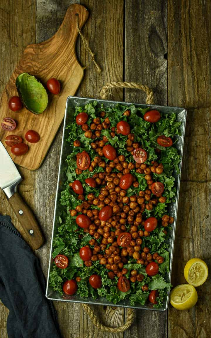 Kale salad with chipotle chickpeas and tomatoes.